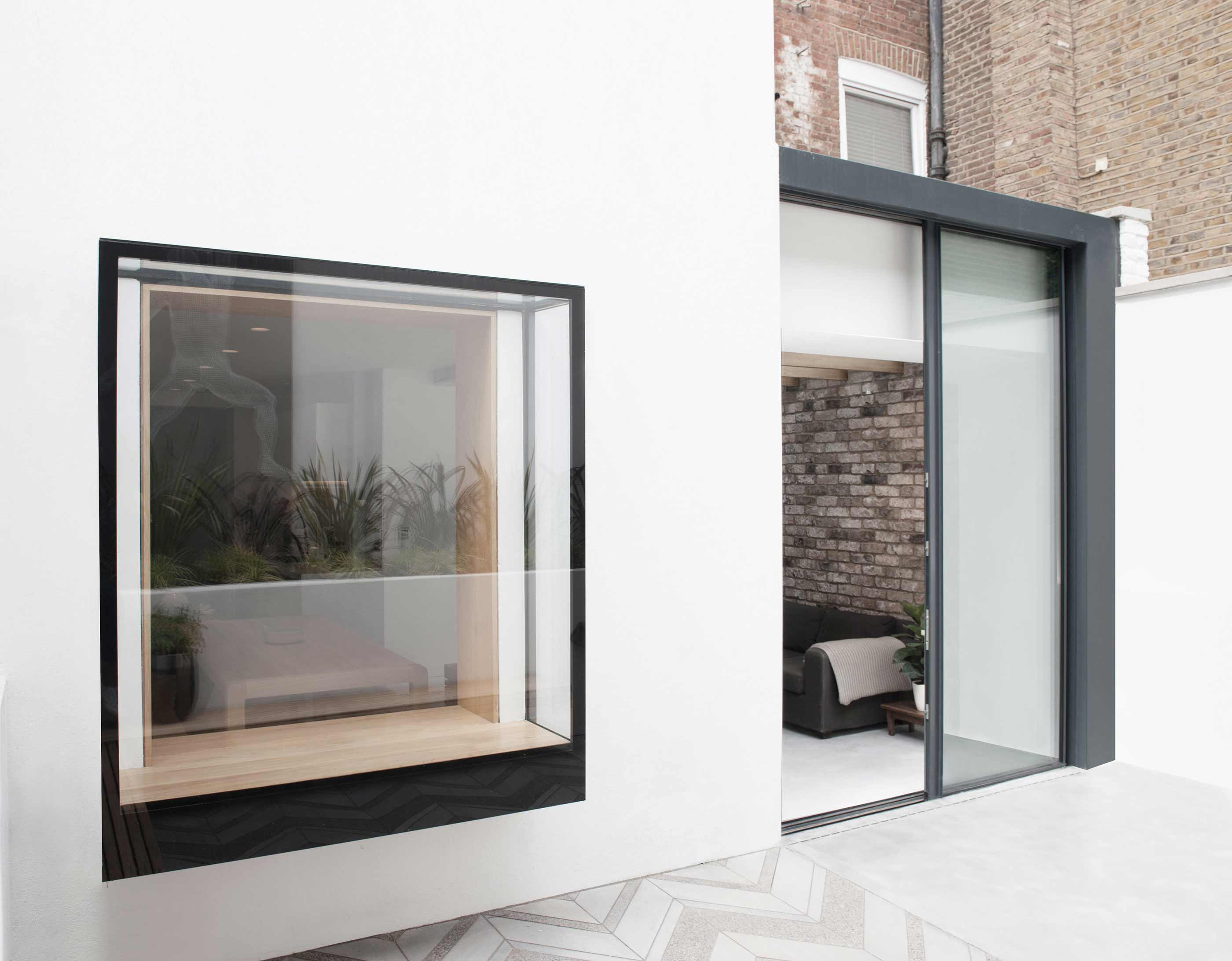 Notting Hill - Westbourne Park Road garden flat extension oriel window bespoke concrete paving garden design sliding doors