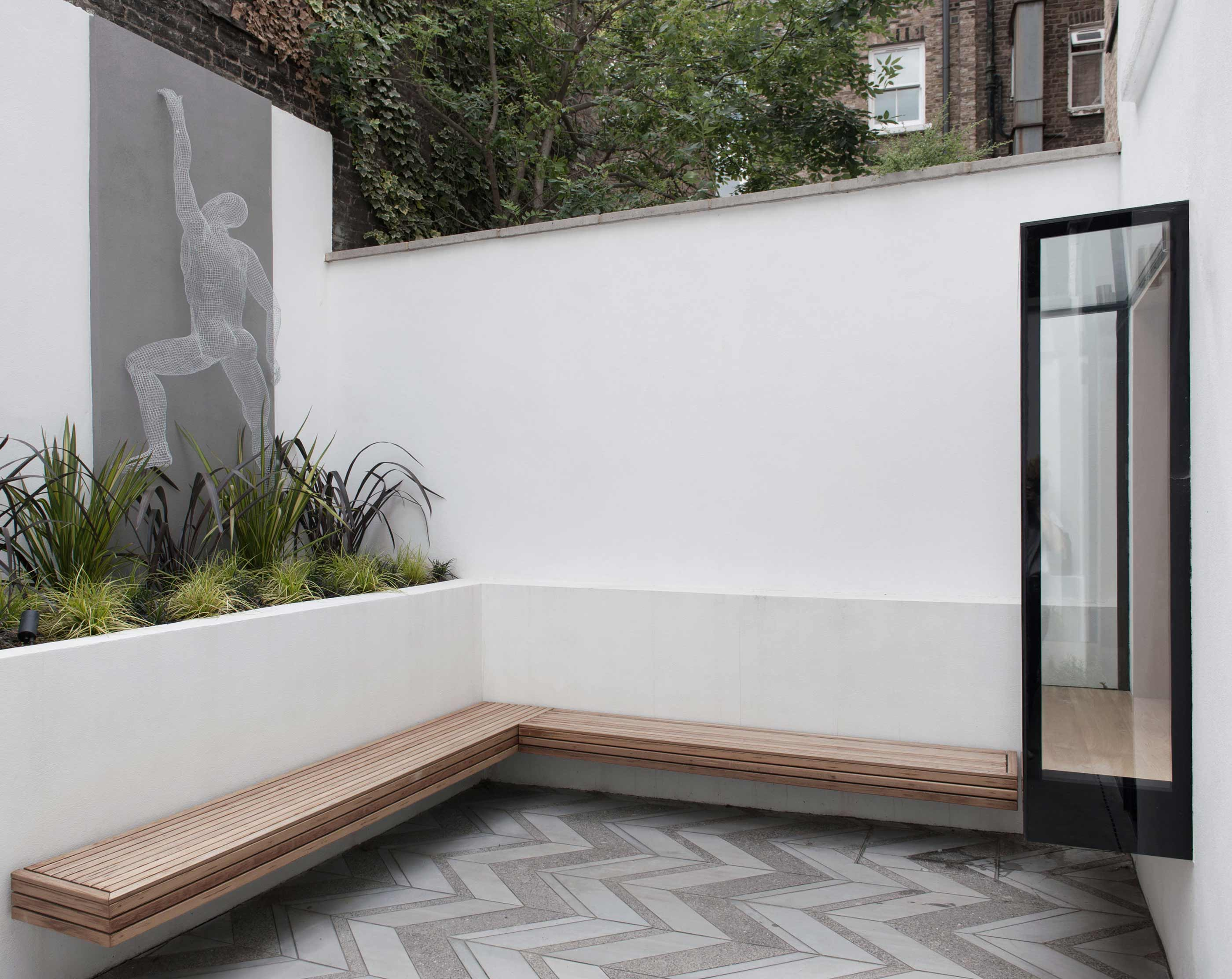 Notting Hill Westbourne Park Road garden flat extension oriel window bespoke concrete paving garden design
